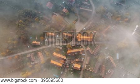 Aerial View Of A Small Village In Fog.top View Of Traditional Housing Estate In Czech.looking Straig