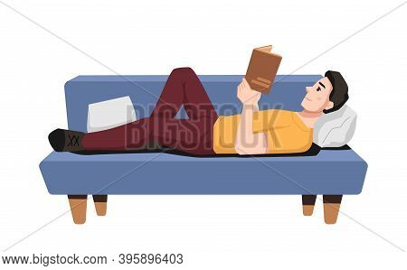 Guy Laying On Couch Enjoying Reading Book. Student Or Bookworm With Textbook On Sofa. Leisure Or Pas