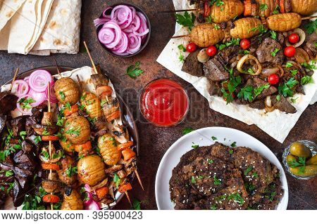 Different Dishes Of Liver Kebab. Skewered Liver, Whole Vegetables And Mushrooms On Skewers. Grill Re