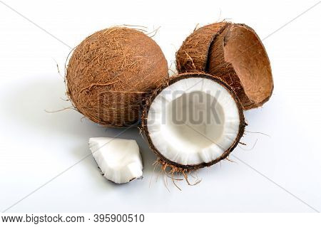 Coconut On A White Background. Whole Coconut, Halves, Shells, Pieces Of Coconut.