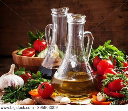Olive Oil And Balsamic Vinegar In Pitchers, Vegetables, Herbs And Spices, Dark Wood Background, Sele