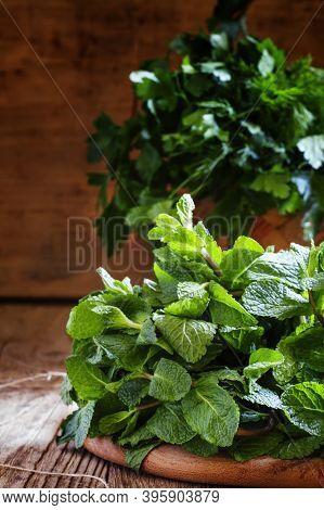 Fresh Peppermint And Other Herbs, Wood Background, Country Style, Selective Focus