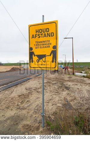 Yellow Distance Warning Shield On A Construction Site In The Netherlands Saying: