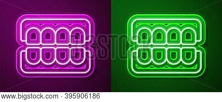 Glowing Neon Line False Jaw Icon Isolated On Purple And Green Background. Dental Jaw Or Dentures, Fa
