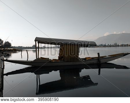 Dal Lake In Srinagar Kashmir With Shikara In Water.