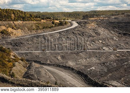 Panoramic Aerial View Of Coal Mine. Open Pit Mine Industry, Big Yellow Mining Truck For Coal Quarry.