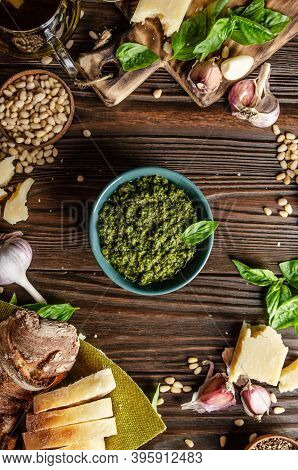 Flat Lay View At Food Background With Genovese Pesto Sauce In The Middle Of Wooden Kitchen Table Rep