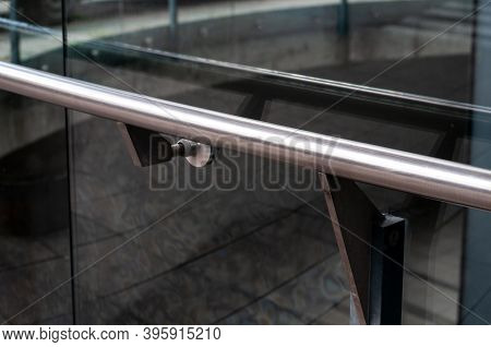 Close-up Of A Railing At A Glass Wall Of An Office Building In A City