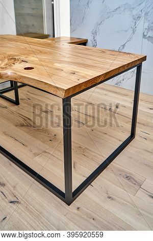 Live Edge Elm Desk With Metal Base In A Modern Home Office. Fragment Of The Desk