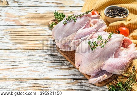 Whole Raw Free Range Chicken With Thyme And . White Background. Top View. Copy Space