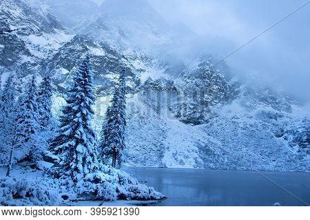 Winter Mountain Landscape. Icy Lake In Winter Snowy Forest. Beautiful Frozen Nature. Scenery Winter