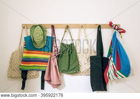 Reusable Cloth Bags Hang In A Row. Eco-friendly Lifestyle And Store Shopping.