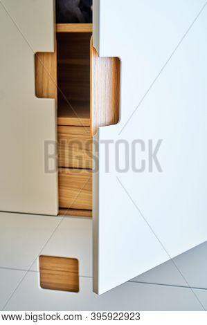 Detail Of The Wardrobe Close-up. Modern Wooden Wardrobe With Flat Finger Pull Wardrobe Doors. Oak Ve