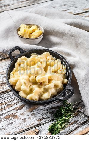 Mac And Cheese, American Style Macaroni Pasta In Cheesy Sauce. White Wooden Background. Top View