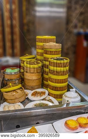 Stack Of Chinese Dimsum Bamboo Steamer Boxes Served In Restaurant