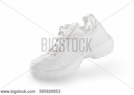 White Sneaker. One White Sneaker Isolated On White Background. Simulation Of The Walking Process. In