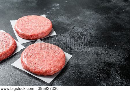 Raw Ground Meat Cutlet, Mince Beef. Burger Patties. Black Background. Top View. Copy Space