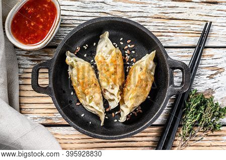 Fried Japanese Gyoza Dumplings In A Pan. White Wooden Background. Top View