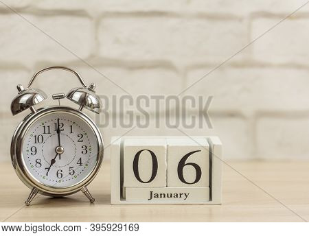 January 6 On A Wooden Calendar Next To The Alarm Clock.one Day In January.winter Day.copy Of The Spa