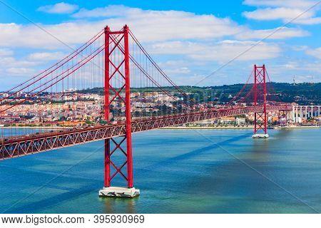 25 De Abril Or 25 April Bridge Is A Bridge Connecting The Lisbon City To The Almada Municipality On