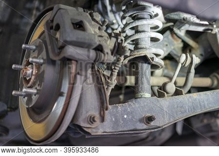 The Hub Of A Wheel In A Car Service. Suspended Car With No Wheels. Suspension Of Car In Service Room