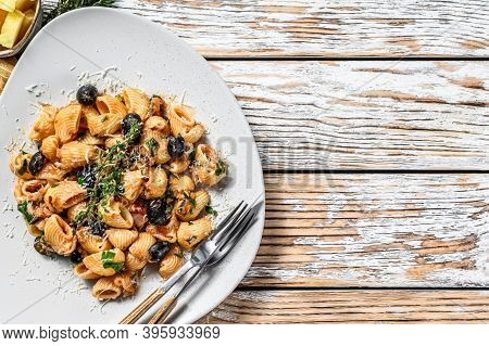 Pasta Puttanesca With Tuna Fish, Tomatoes, Garlic And Black Olives. White Background. Top View. Copy