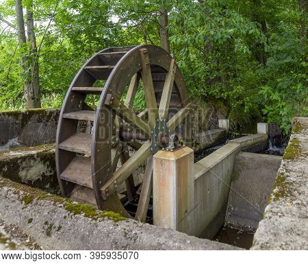 Old Rundown Water Wheel Seen In The Bavarian Forest At Summer Time