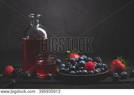 Red Fruit Detox Juice With Berries On Dark Background.