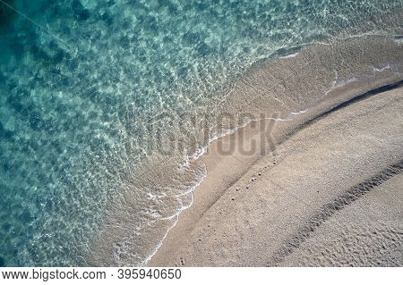 Top View Of Beach And Coastline With Clear Water. Tropical Sandy Beach And Crystal Ocean Water. View