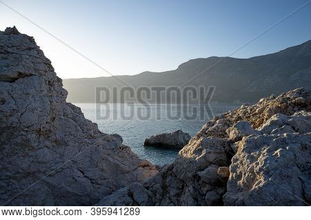 Picturesque View Of Rocky Cliffs In Amazing Sea. Rocky Coast With High Cliffs. Travel Concept.