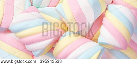 Marshmallow Pattern Background.  Pastel Colored  Marshmallows Sweet Dessert Food Close-up. Wide Back