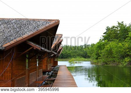Wooden Houses Floating On River Or Lake For Tourist Take Rest And Chill Out Among Beauty Of Nature W