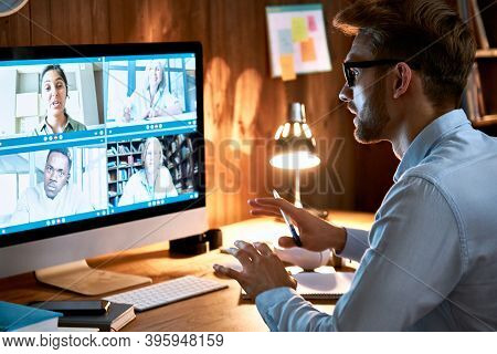 Businessman Executive Leading Virtual Team Meeting On Video Conference Call Using Computer Working F
