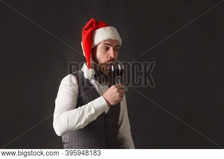 Santa With Glass Of Wine. Red Wine. Man In Santa Hat With Glass Of Wine. Man In Suit Drinks Wine. Al