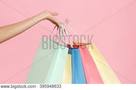 Big Sale, Low Prices And Lots Of Purchases. Hand Of African American Millennial Woman Holds Many Col