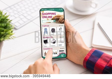 Online Shopping. Male Hands Holding Phone With Internet Shop App On Screen, Buying Things Sitting At
