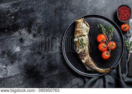 Delicious Grilled Pollock With Fresh Thyme And Tomatoes. Black Background. Top View. Copy Space