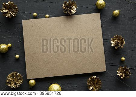 Christmas Card And Golden Pinecones Background, Space For Xmas Text And Greetings, Top View.