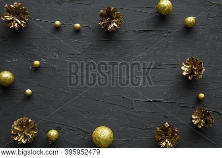 Christmas Golden Pinecones Background, Space For Xmas Text And Greetings, Top View.