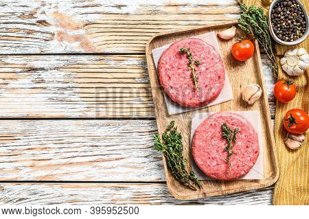 Ground Meat Patties, Raw Mince Beef. White Background. Top View. Copy Space