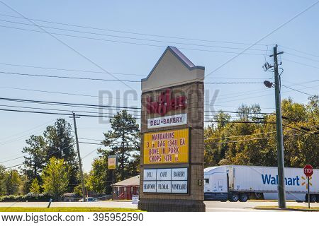 Wrens, Ga / Usa - 11 17 20: View Of Ingles Grocery Store Supermarket Street Sign And Walmart Truck