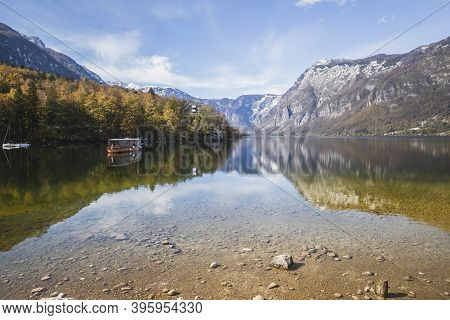 Picturesque Lake Bohinj Which Reflects The Alps. Triglav National Park In Slovenia In Autumn