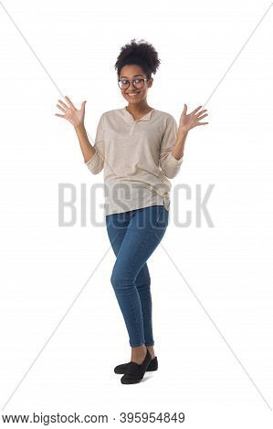 Full Length Portrait Of African American Mixed Race Woman Cheering Smiling With Palms Open Isolated