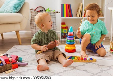 The Little Boys Play With Musical Toys In Kindergarten