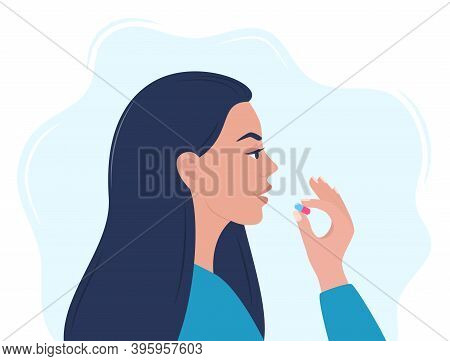 Woman Taking A Pill In To Her Mouth. Woman Holds A Pill In Her Hand And Intends To Take It. Medicati