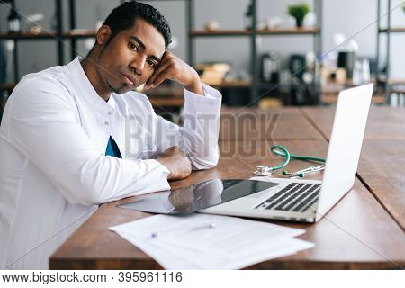 Stressed African American Black Man Doctor Looking At Camera Unhappy Physician In Tension Feeling Ti