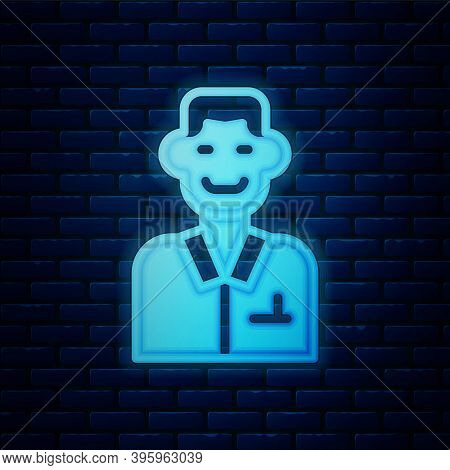 Glowing Neon Trader Icon Isolated On Brick Wall Background. Businessman Trading Stocks. Vector