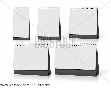 Five White Empty Desk Calendars Of Different Sizes Stand On The Table Mock Up