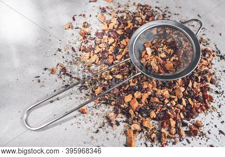 Fruit Tea Of Dried Flowers Petals And Dry Berries With Strainer Or Infuser
