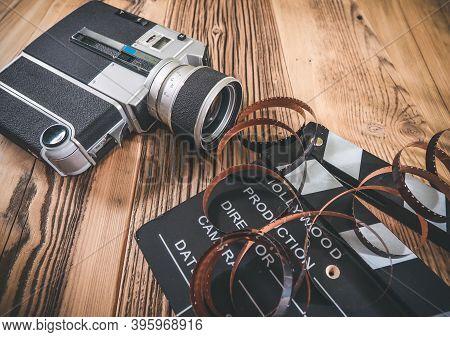 Cinema Movie Clapperboard And Retro Camera With Filmstrip